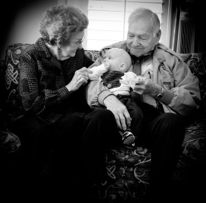 My Granny and Grandpa (married over 70 yrs by the way), gently loving their youngest great-grandchild.